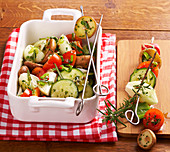 Vegetarian side dishes: grilled marinated vegetable kebabs with courgettes, shiitake mushrooms, pepper and herbs