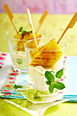 Grilled pineapple with mint yoghurt in glasses