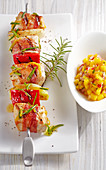 Grilled turkey skewers with mango salsa