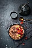 Vegan chocolate millet porridge with fresh fruits