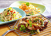 Grilled oriental marinated collar steak with pasta salad and carrots