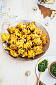 Spring onion bhajis with zhoug for Christmas
