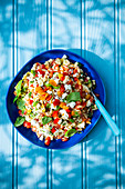 Summer orzo pasta, feta cheese, basil, tomatoes and peppers salad with olive oil