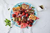Watermelon, grilled halloumi and cherry tomato drizzled with olive oil, mixed with fresh mint and basil