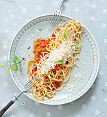 Spaghetti with spelt bolognese and Parmesan cheese