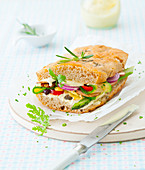 Vegetarian focaccia with remoulade and vegetables