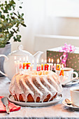 A lemon Bundt cake with birthday candles