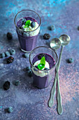 Blackberry and blueberry smoothie with ice cream and fresh mint