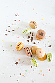 Mixed macarons with colorful sugars and chocolate chips