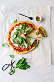 Chickpea pizza with tomatoes, cheese and basil