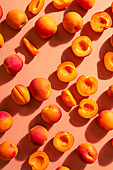 Scattered apricots, whole and halved