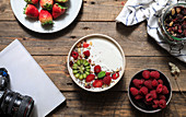 Dessert with red strawberry and raspberry in bowl composed with camera