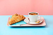 Lavazza black coffee and butter croissant.
