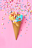 Ice cream cone with colorful ice cream, mini marshmallows, and sugar stars