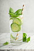 Refreshing basil cucumber cooler in a tall glass