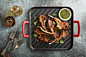 Grilled lamb chops with cilantro and green herb sauce