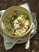 Beer risotto with bacon and peas