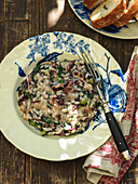 Risotto with radicchio on a ceramic plate