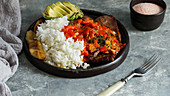 El Bistec a la Criolla - colombian beef steak with tomatoes sauce, rice, avocado, bananas fries