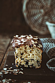 Stracciatella cake with milk chocolate glaze and almond flowers
