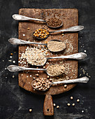 Healthy gluten free grains on rustic wooden board