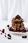 Pancakes with berry sauce and fresh berries