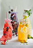 Flavoured water with cherries, berries, oranges and lemon