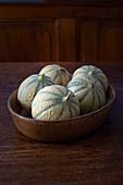 Mini melons in a ceramic bowl