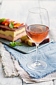 A glass of rose wine and pepper carpaccio terrine