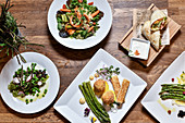 Various dishes with green and wild asparagus