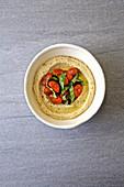Hummus with basil and sun dried tomatos