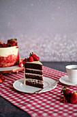 A red velvet cake with fresh berries