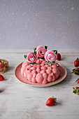 Strawberry mousse cloud cake with meringue flowers