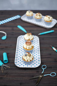 Cupcakes with vanilla cream and button decorations
