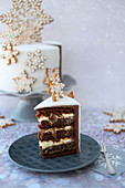 A slice of Christmas cake decorated with snowflakes