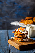 Latkes with fried leeks, sour cream and red trout caviar