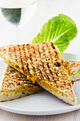 A grilled sandwich filled with vegetable spread