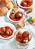 Roasted meatballs with an onion sauce and a mozzarella filling