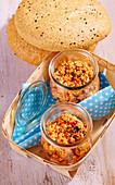 A Mediterranean feta cheese spread in glasses with unleavened sesame seed bread