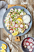 Potato salad with smoked trout, red radishes and mustard-yogurt dressing