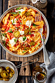 Tagliatelle in tomato sauce with mozzarella and jalapeno