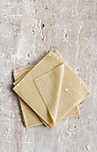 Won ton dough sheets on a stone background