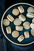 Macarons made of pumpkin flour with with chocolate ganache