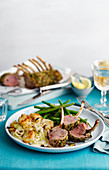 Mustard Herb Crusted Lamb Rack with beans and potatoes
