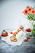 A wholegrain sponge roll with mascarpone cream and dressed with strawberries