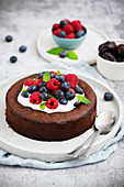 Brownie cake without flour and sugar served with Greek yogurt and berry fruits