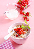 Bircher muesli with oats, red berries and milk
