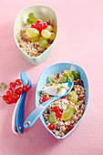Bircher muesli with oats, grapes, redcurrants, raisins and yoghurt