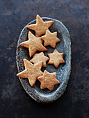 Star-shaped cookies in terracotta dish
