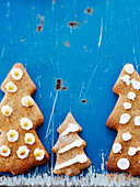 Christmas tree cookies on blue background